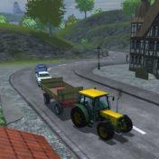 Traktor hält den Verkehr im Ort auf